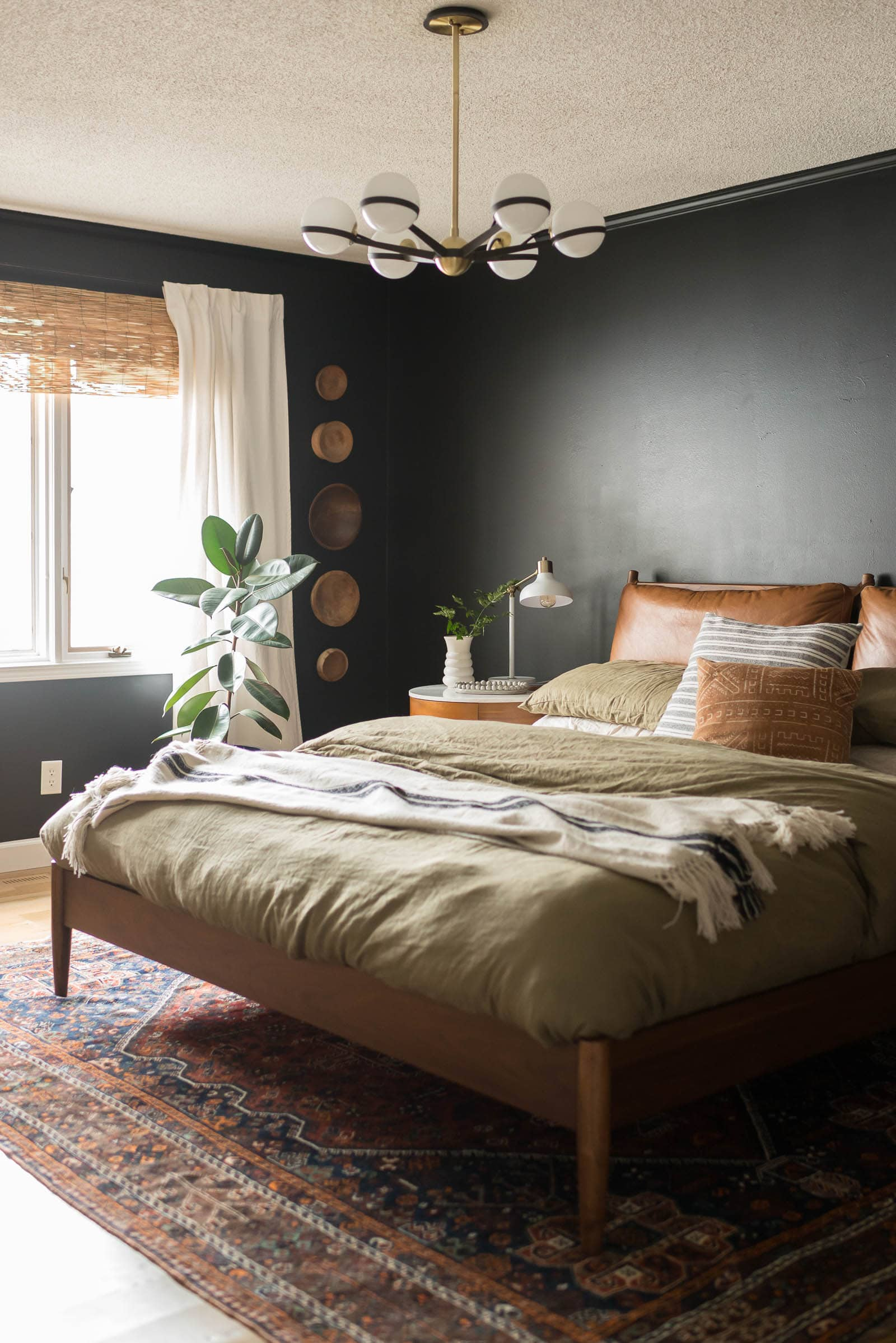Midcentury Modern bedroom with black paint