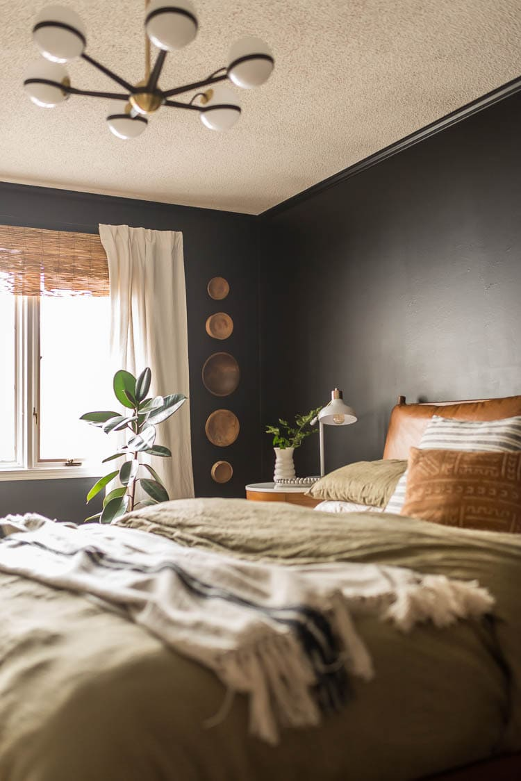 Dark bedroom with wood bowls on wall