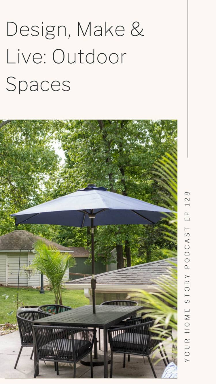 Outdoor patio space featuring a black table, blue umbrella on concrete, etc.