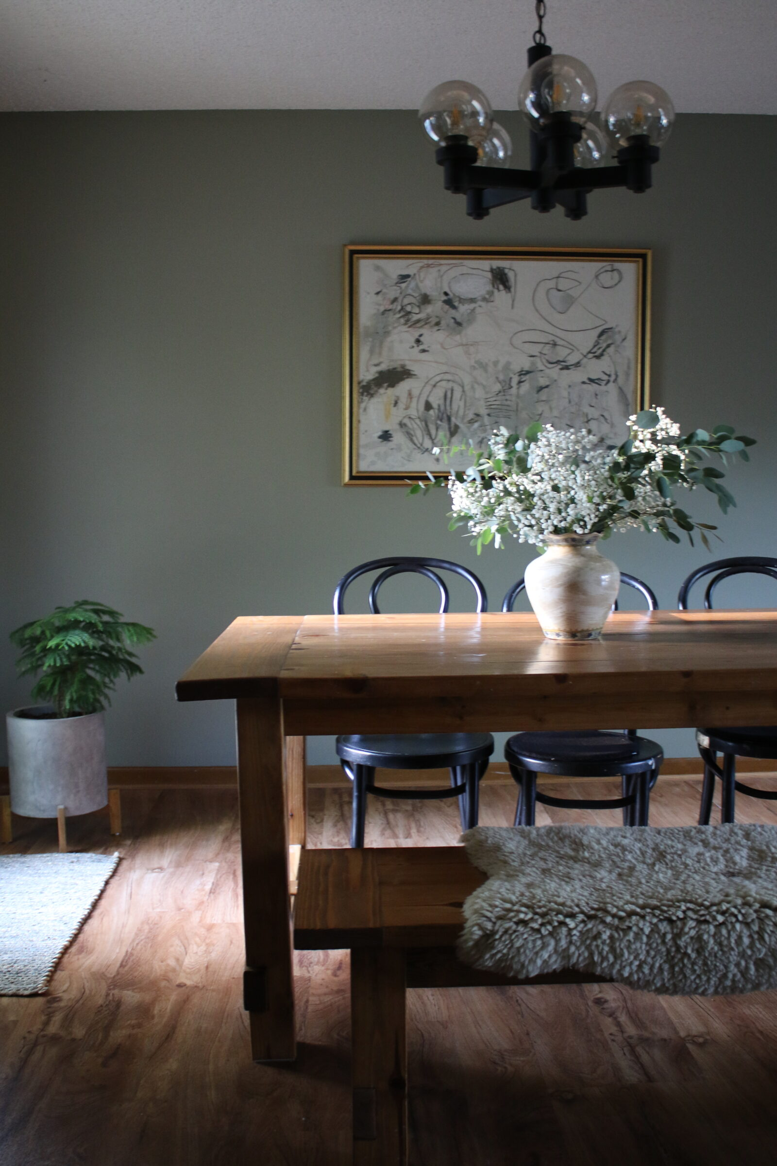 Dining Room featuring a wood table, black chairs with intentional living as the the focus