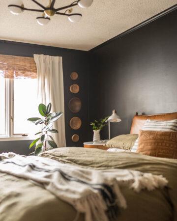Cheap wooden bowls on wall in bedroom with a tutorial on how to hang wooden bowls on the wall