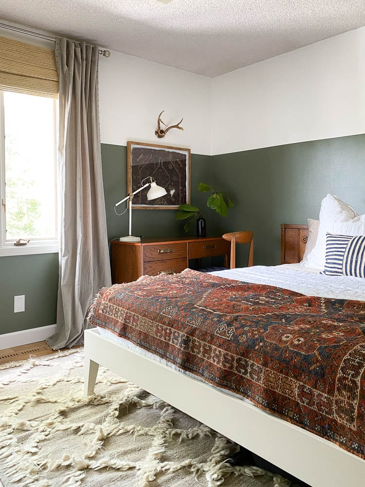 Mid-Century Modern Bedroom with vintage rugs, green walls and lots of textiles.