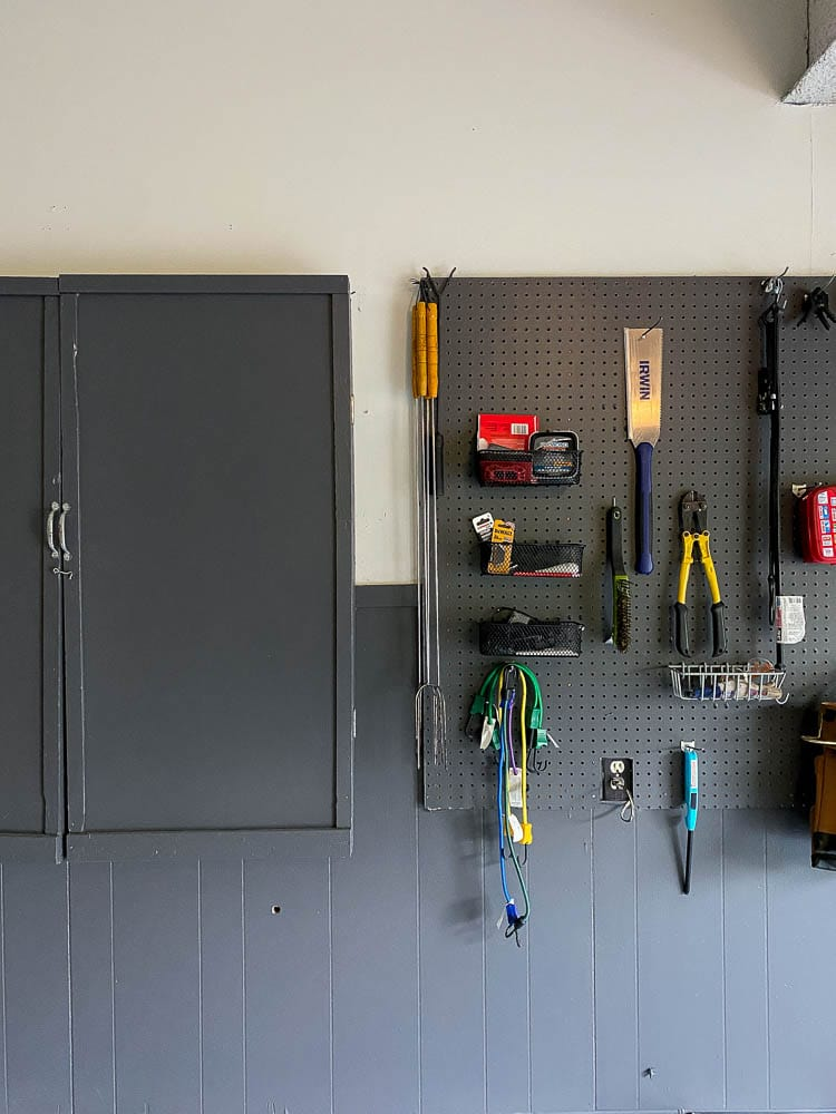 Organize household supplies showing on a peg board in garage