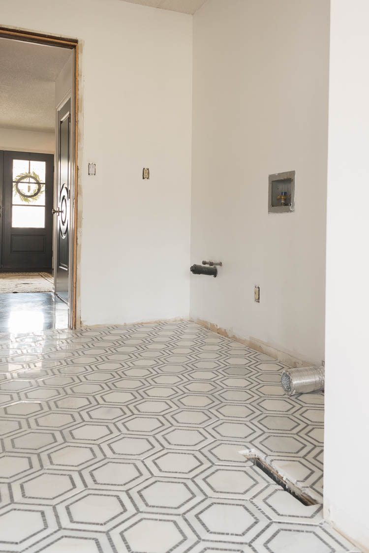 laundry room hexagon marble tile installed