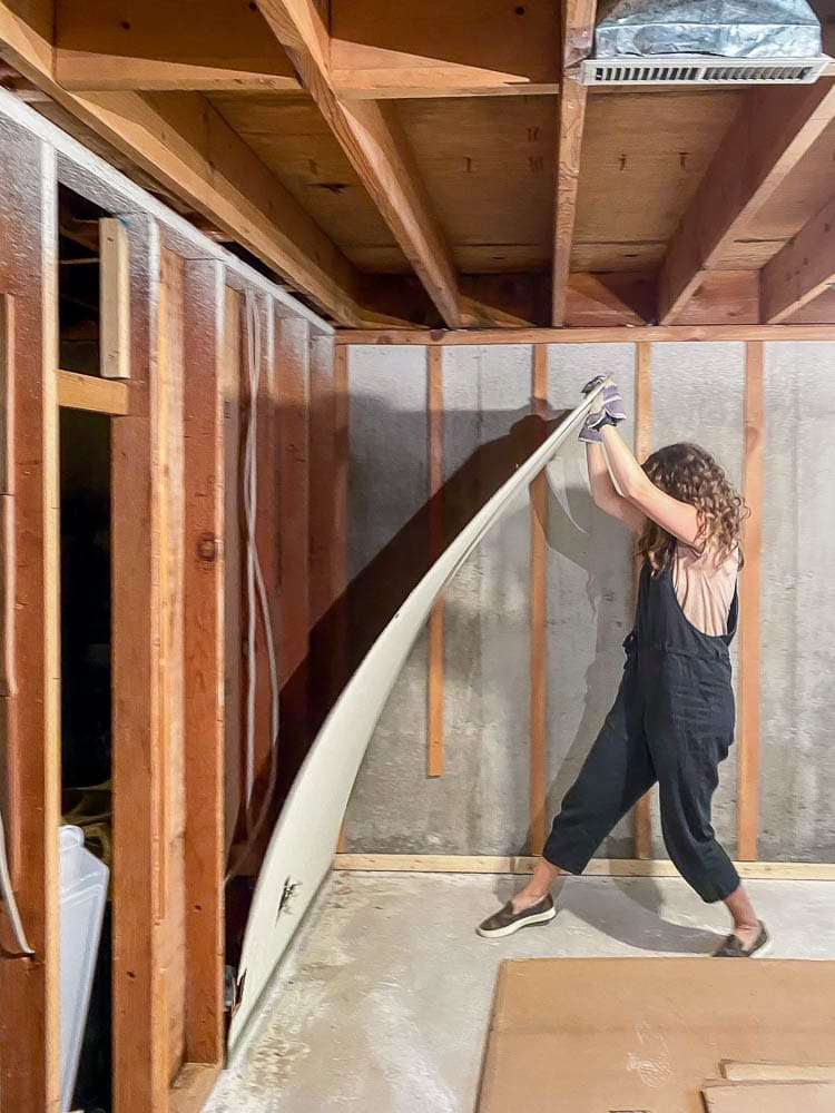 Woman taking down wall paneling