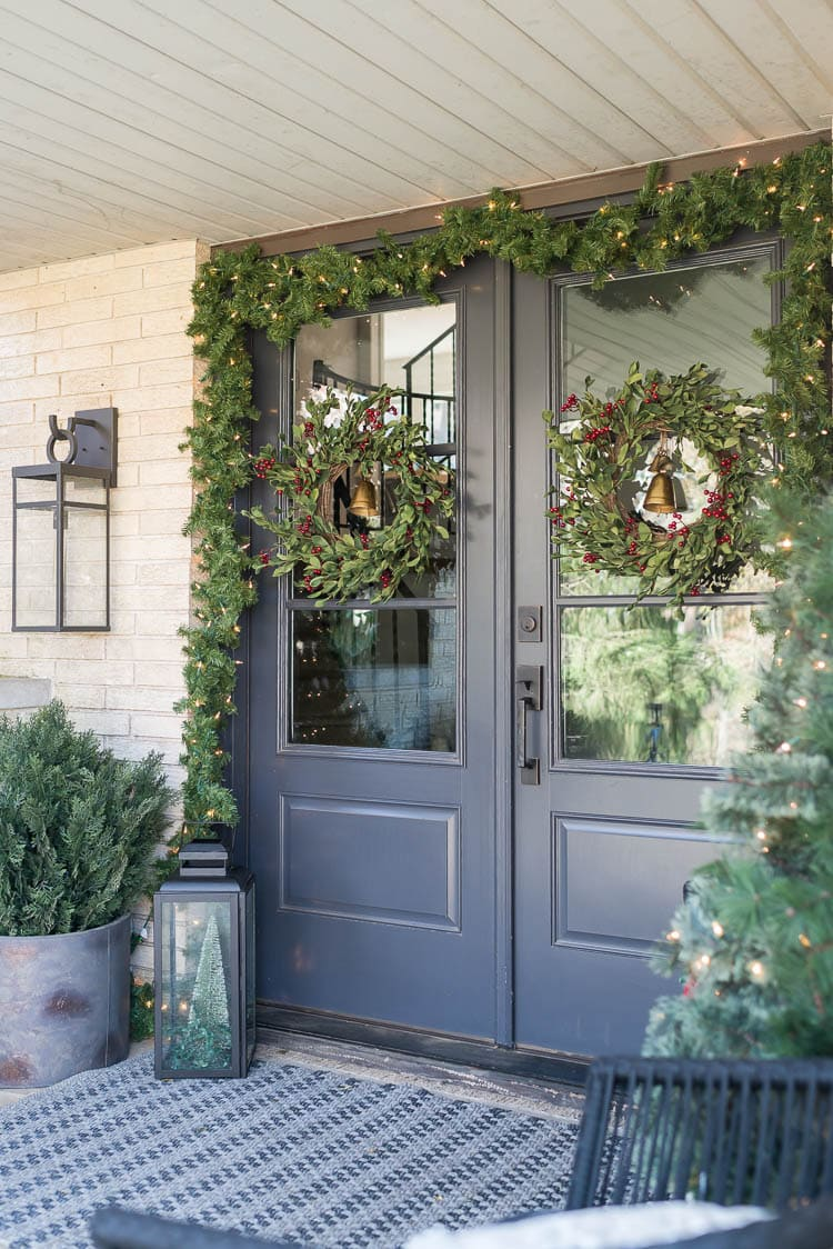 Front porch with double front doors decorated for Christmas