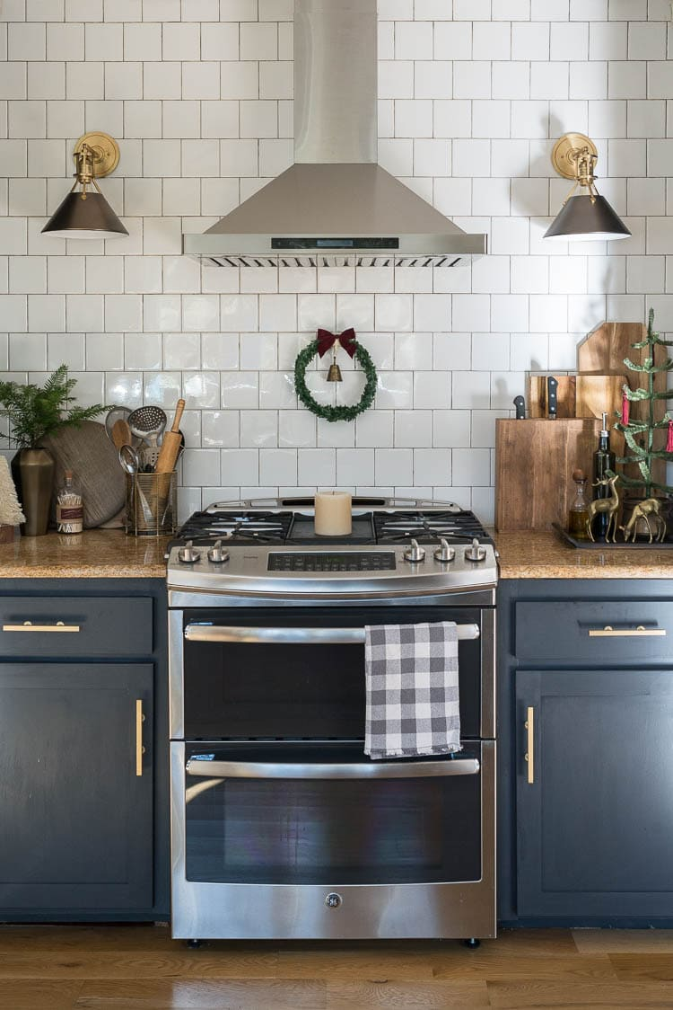 Kitchen decorated for Christmas with wreath over oven and universal knife holder