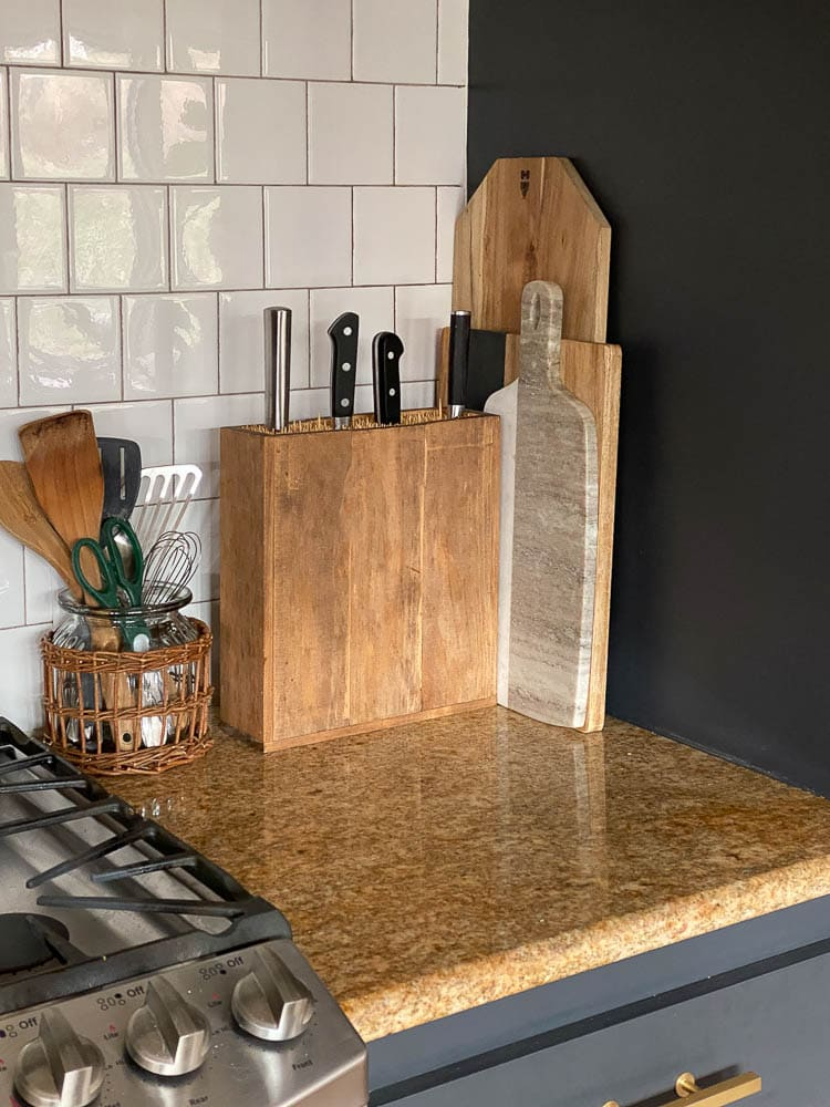 wooden knife block (diy) sitting on a kitchen countertop