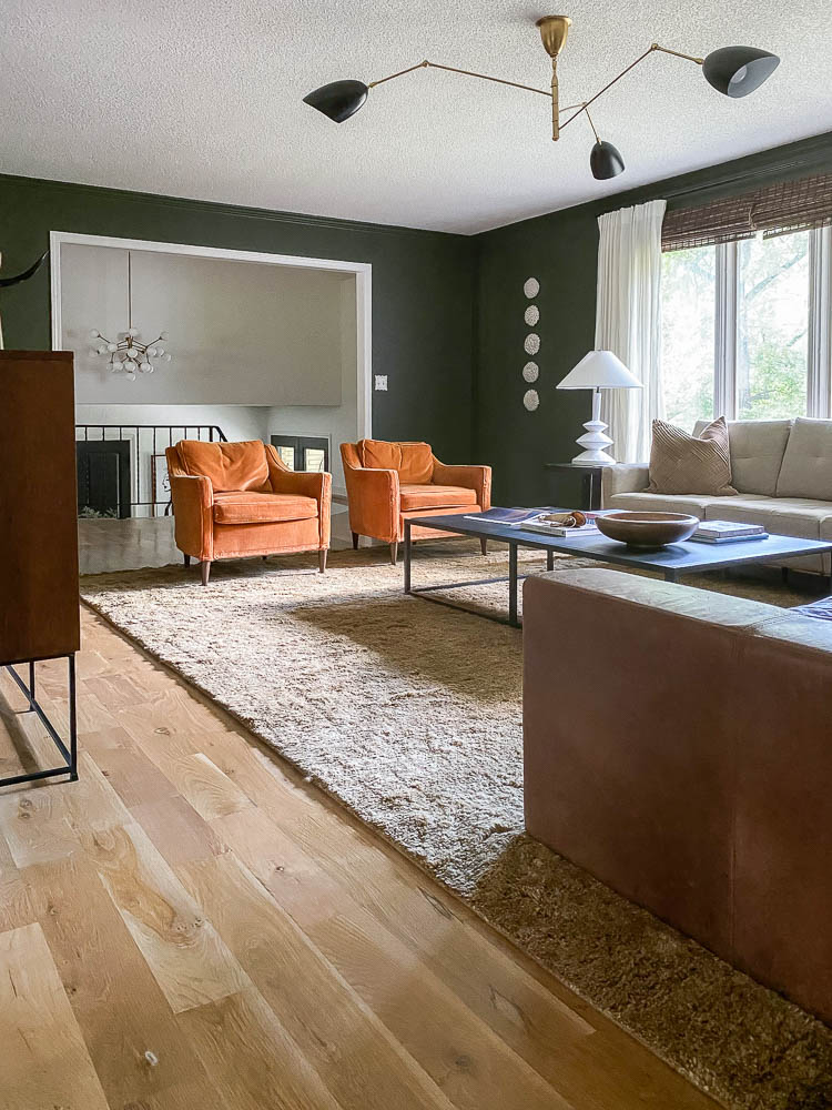 orange velvet chairs in living room