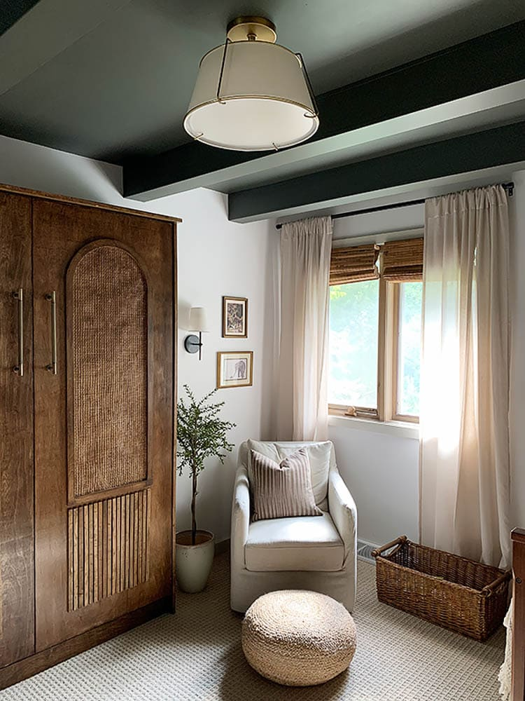 Nursery with wood Murphy bed and green ceiling