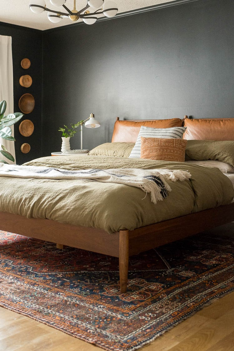 vintage rug under bed with midcentury furniture