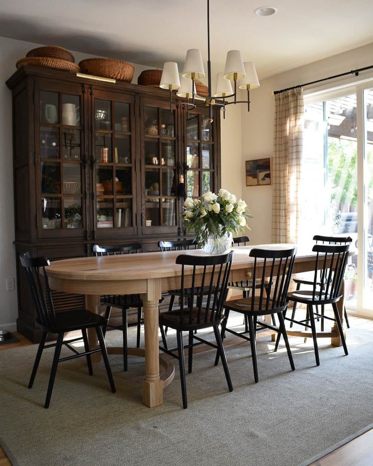 Modern Traditional dining room with oak table and black chairs.