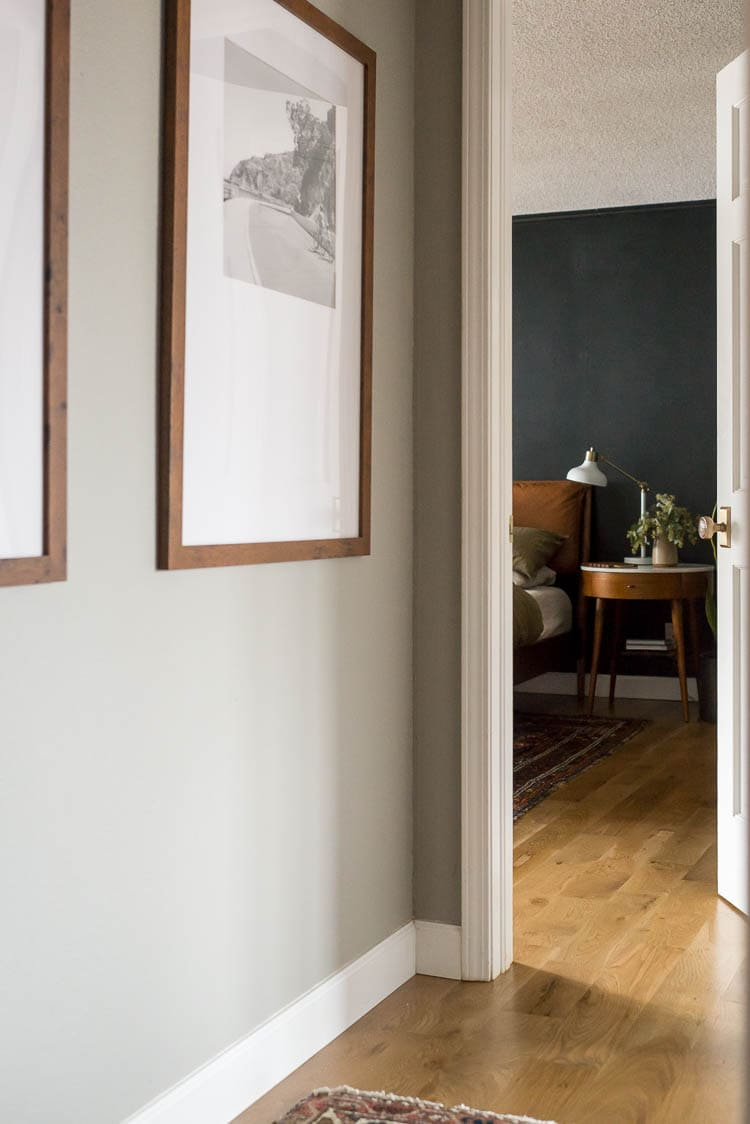 how to cope baseboards showing a hallway with a baseboard coping cut in the corner