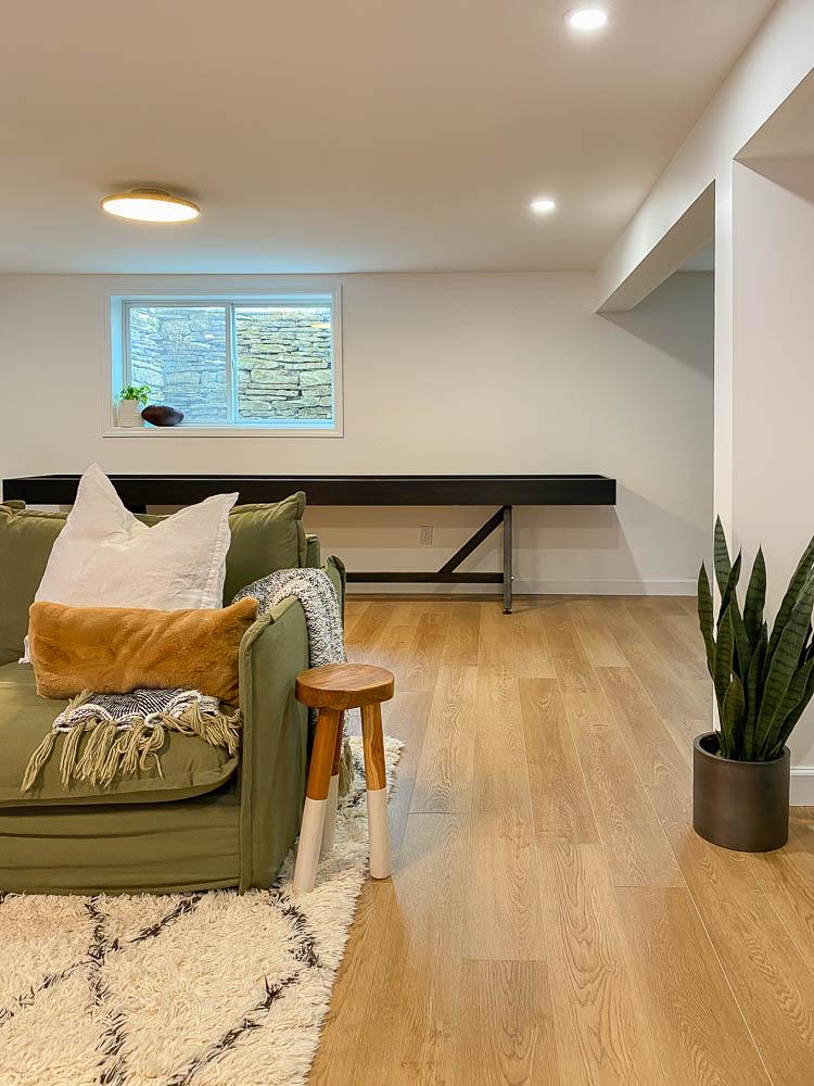 sharing a custom shuffleboard in a basement