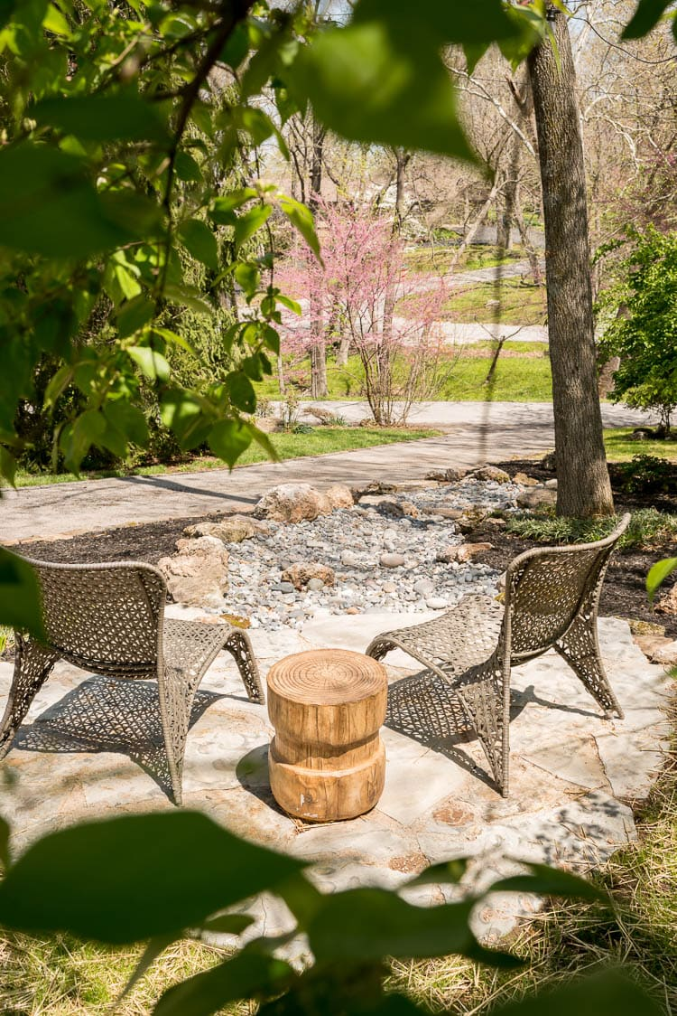 Flagstone patio in the front yard with a dry creek flowing beneath it.
