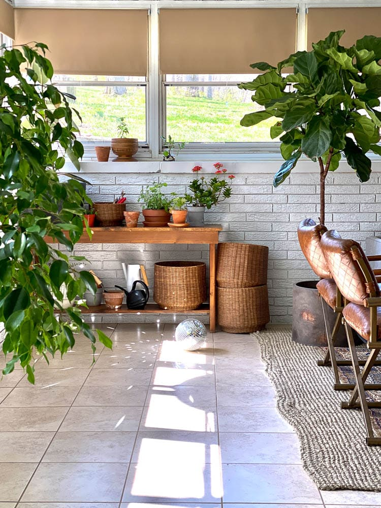 Sunroom ideas: showing a potting bench in the corner with plants