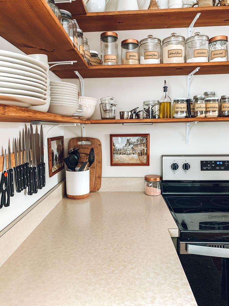 Vintage art under kitchen shelves