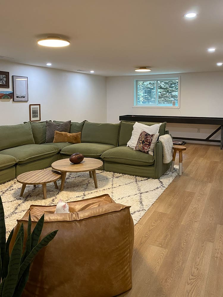 Best lighting for basement showing a basement with a mix of recessed lighting and low profile lights
