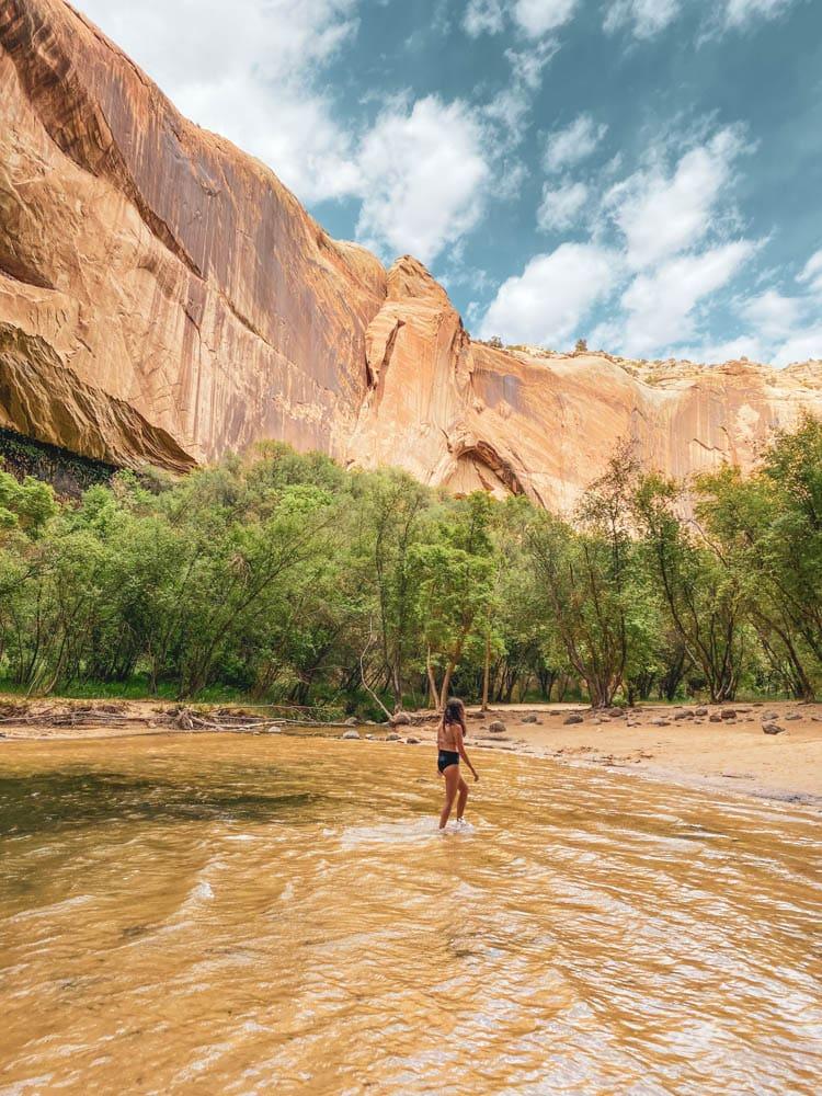 Swimming in Calf Creek Falls Utah after hiking the Lower Calf Creek Falls trail.