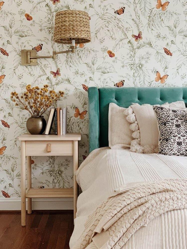 Butterfly wallpaper in bedroom. Bedroom designed by StyleMutt Home.