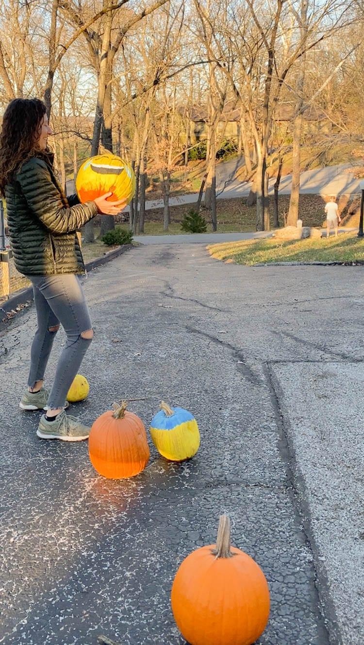 at home halloween tradition - pumpkin bowling