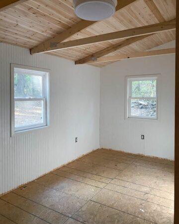 cedar plank ceiling progress at the family cabin